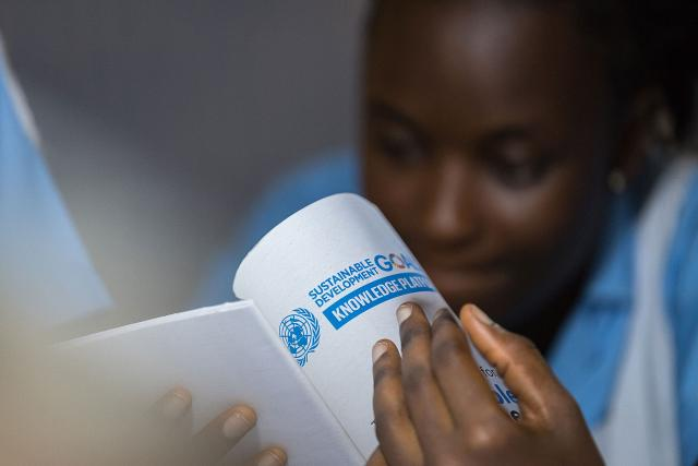 A female nurse at Ganta United Methodist Hospital reads about the SDGs.