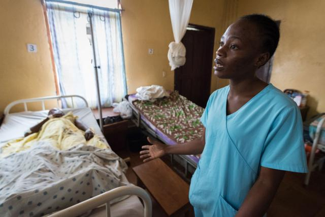 Ganta Hospital nurse Loretta Nyawonse tends to a young female patient recovering from surgery.